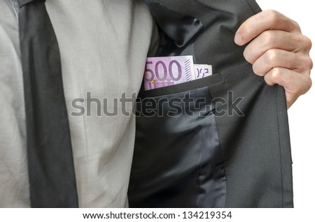Businessman showing money in inner pocket of his suit. Concept of corrupted businessman.