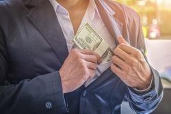 businessman showing packs of international bank note