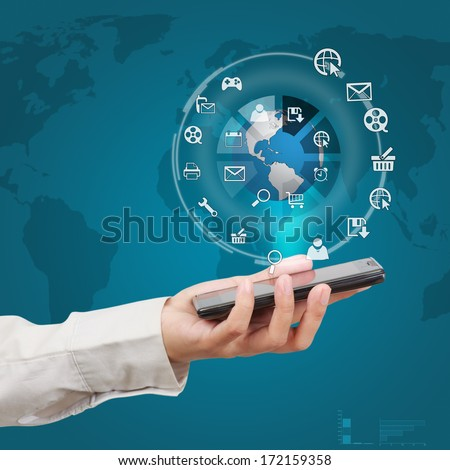 Businessman showing smartphone with globe and icon application on virtual screen. Concept of online business.