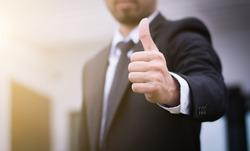 Businessman showing thumbs up - closeup shot