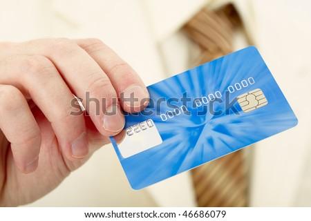 Businessman shows a blue plastic credit card