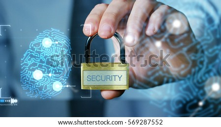 Businessman shows a padlock with security symbol with futuristic holographics about services and safety.Concept of password,Protection system files from technological hacker internet or banking system