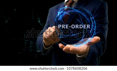 Businessman shows concept hologram Pre order on his hand. Man in business suit with future technology screen and modern cosmic background