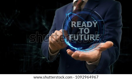 Businessman shows concept hologram Ready to future of internet on his hand. Man in business suit with future technology screen and modern cosmic background
