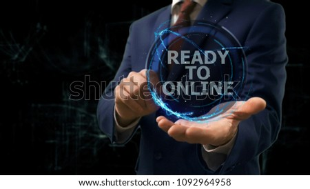 Businessman shows concept hologram Ready to online on his hand. Man in business suit with future technology screen and modern cosmic background