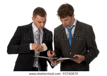 Businessman signing a contract. The deal is payed in cash money. Isolated on white