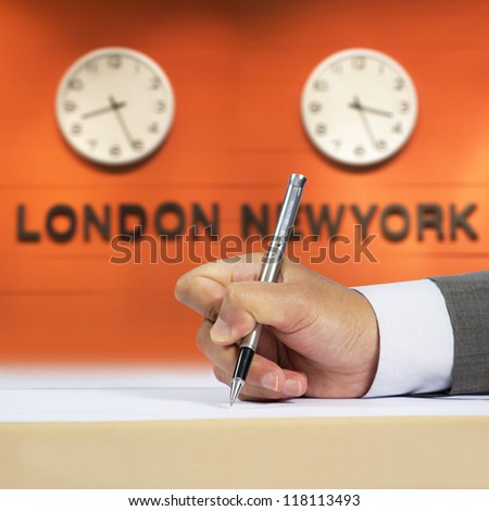 Businessman signing document and time