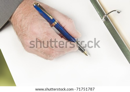Businessman signing documents, contact. Focus on hand.