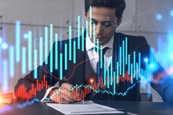 Businessman signs contract and financial chart hologram. Double exposure. Formal wear. Concept of brokerage.