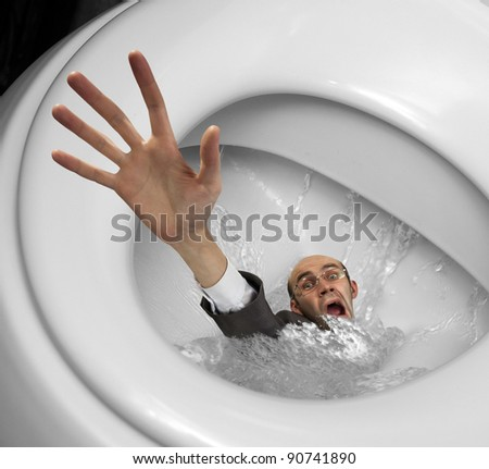 Businessman sinking in toilet bowl. Close-up view