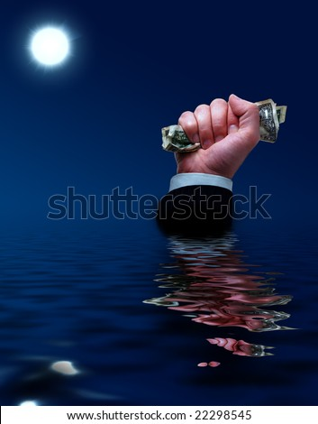 Businessman sinks with cash in his hands