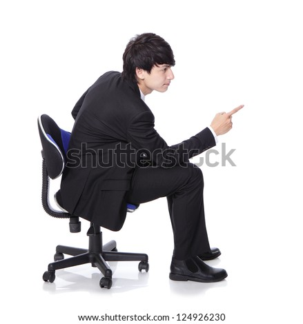 businessman sit on chair and hand finger point to empty copy space, concept of advertisement product isolated over white background, asian model