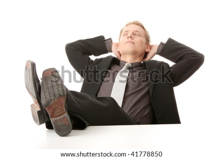 Businessman sitting at desk, isolated