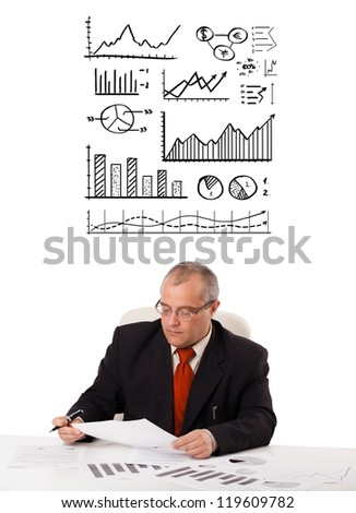 businessman sitting at desk with statistics and graphs, isolated on white