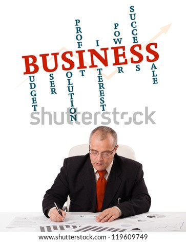 businessman sitting at desk with word cloud, isolated on white