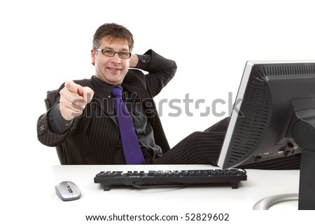 stock-photo-businessman-sitting-behind-desk-is-pointing-at-you-over-white-background-52829602.jpg