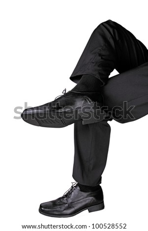 businessman sitting cross legged