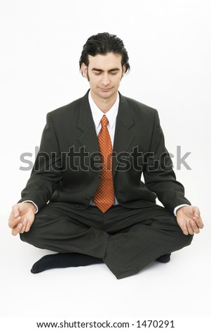 Businessman sitting cross legged in meditation and relaxation