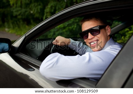 Businessman sitting in the car. - stock photo