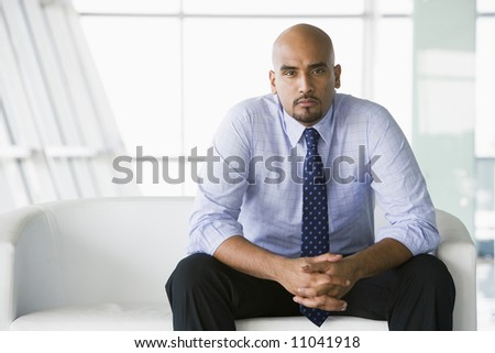 Businessman sitting indoors