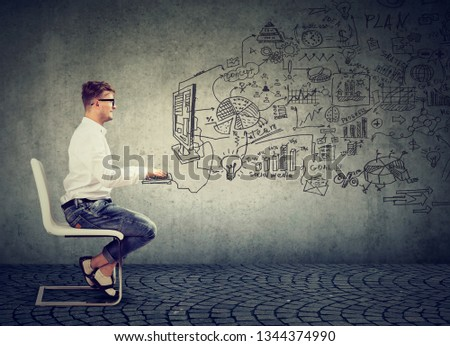 Businessman sitting on chair and working online on computer creating social media business  #1344374990