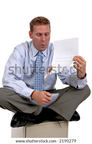 Businessman sitting on file cabinet burning a bad contract