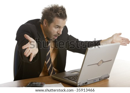 Businessman sitting on his desk and has a lot of stress, because of a computer crash