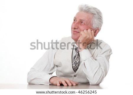 businessman sitting pensively against a white background