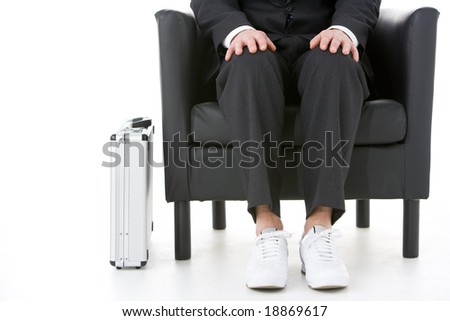 Businessman Sitting Wearing Sneakers