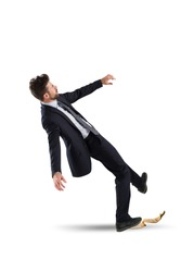 Businessman slips on a banana peel. concept of unlucky and failure