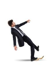 Businessman slips on a banana peel. concept of unlucky and failure