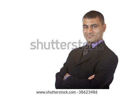 Businessman smiles self confident in camera. Isolated on white background.