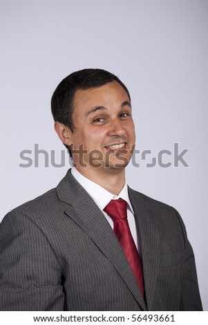 businessman smiling with a grey background