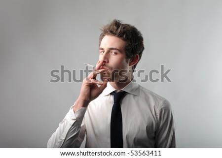 Businessman smoking a cigarette