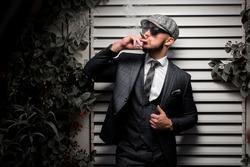 Businessman smoking a cuban cigar.