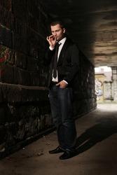 businessman smoking in tunnel