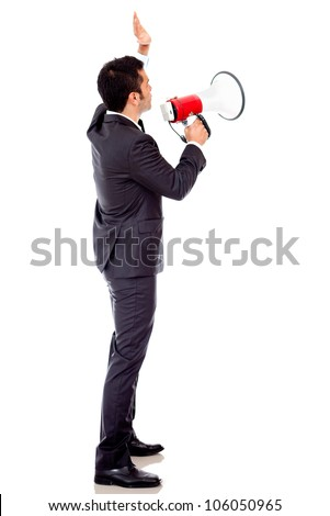 Businessman speaking loud through a megaphone - isolated over a white backround
