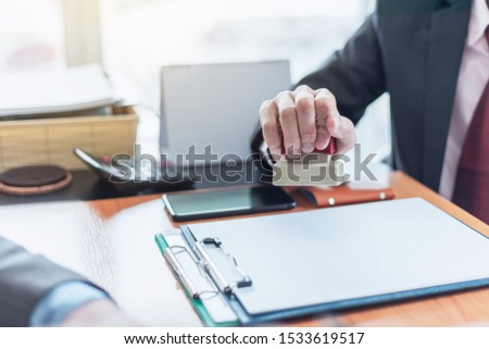 Businessman stamping with approved stamp on document at office. #1533619517