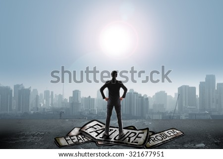Businessman stand on problem traffic sign looking at sun, success concept #321677951