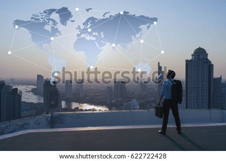 Businessman stand on roof top of building,  globalization conceptual #622722428