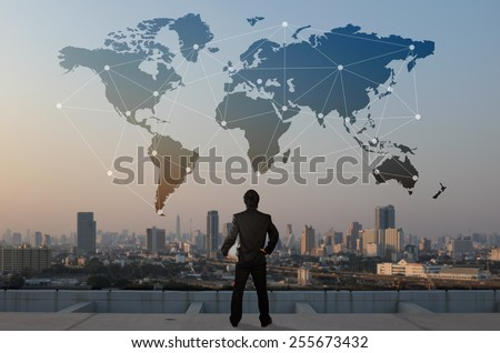 businessman stand on roof top of skyscraper, business globalization concept