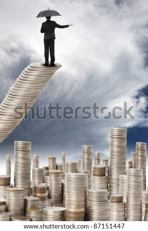 businessman stand on the money stair and watching the storm coming