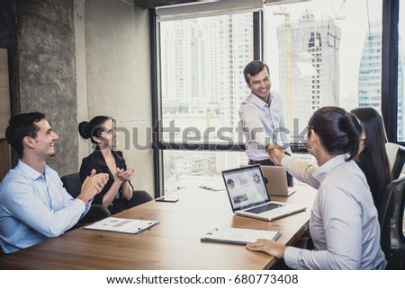 Businessman standind for present the project with team, Portrait business leader concept, 20-30 year old, vintage tone