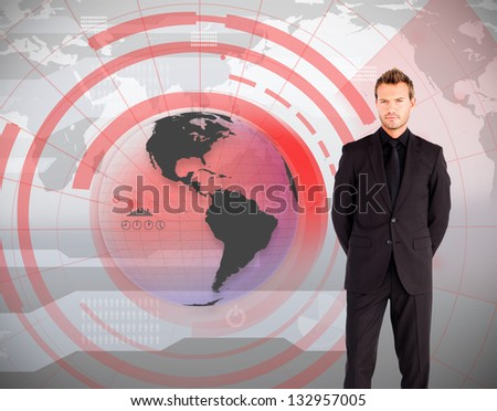 Businessman standing against global interface in red and grey