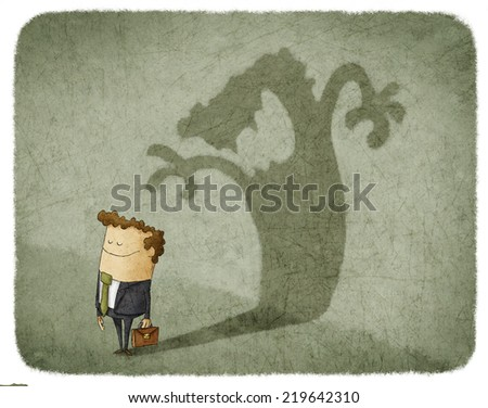 Businessman standing and casting shadow of an angry man