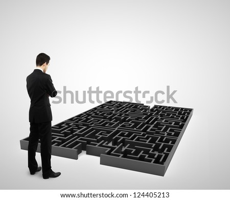 businessman standing and looking to black labyrinth