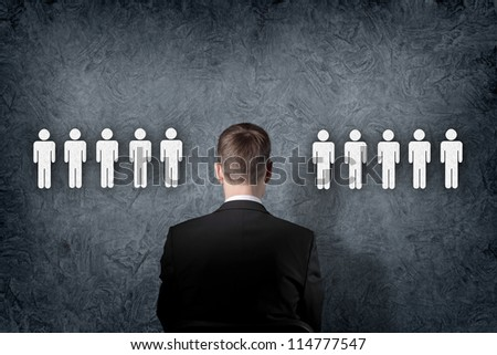 Businessman standing and making decision and choosing between people