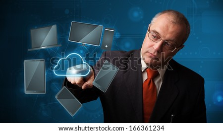 Businessman standing and touching high technology cloud service