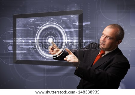 Businessman standing and touching modern technology tablet