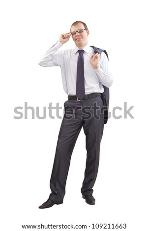 Businessman standing at full height one hand holds the handle of glasses and the other thrown over the shoulder of jacket - stock photo